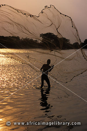 Traditional fisherman with net in the Baro River, Gambela, Ethiopia