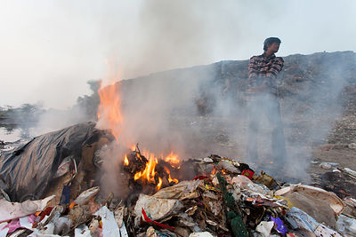 Plastic burns in a fire at the Dhapa landfill, Kolkata, India. Dhapa is the main landfill for Kolkata's 13 million people.