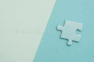 isolated blue Puzzle piece on blue paper background