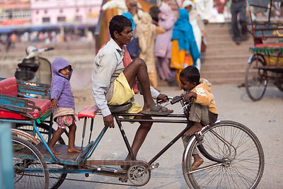 Cycle rickshaw driver and his children, Haridwar, India