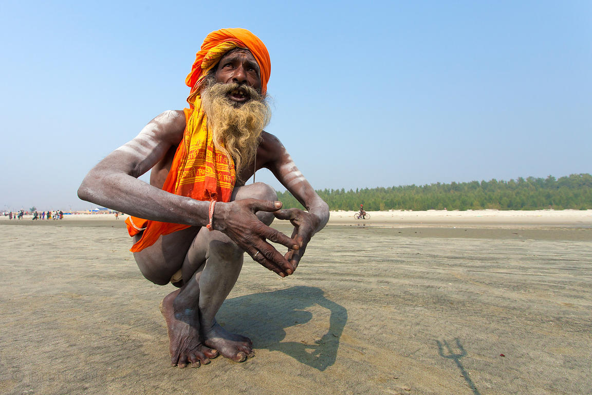 An elerly sadhu (holy man) does yoga at the Gangasagar Mela, a Hindu pilgrimage to Sagar Island in the Bay of Bengal in India...