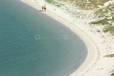 Looking down on couple walking along white sandy beach, Balandra Bay, Baja California, Mexico, September 2007