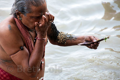 Hindus pray in the Hooghly River in observance of Mahalaya, a tribute to deceased relatives.