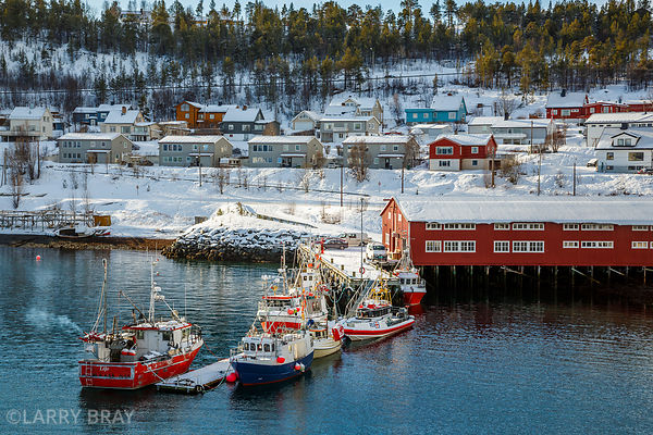Boats and houses in the snow in the harbour, Alta Norway
