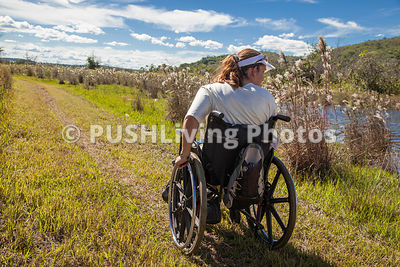 Group of adults with disabilities on a country hike.