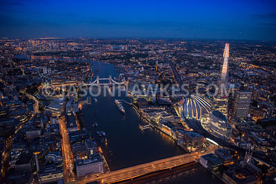 Aerial view of London, London Bridge towards Tower Bridge at night.