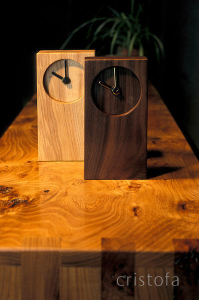 wooden clocks standing on an elm sideboard