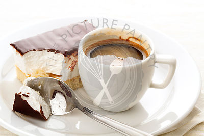 Espresso cup with chocolate covered Marshmallow on white plate