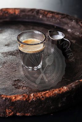 Glass of espresso with milk
