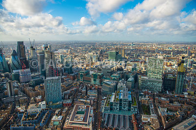Aerial view of City of London with Shoreditch and Spitalfields with construction of 22 Bishopsgate and Principal Tower.