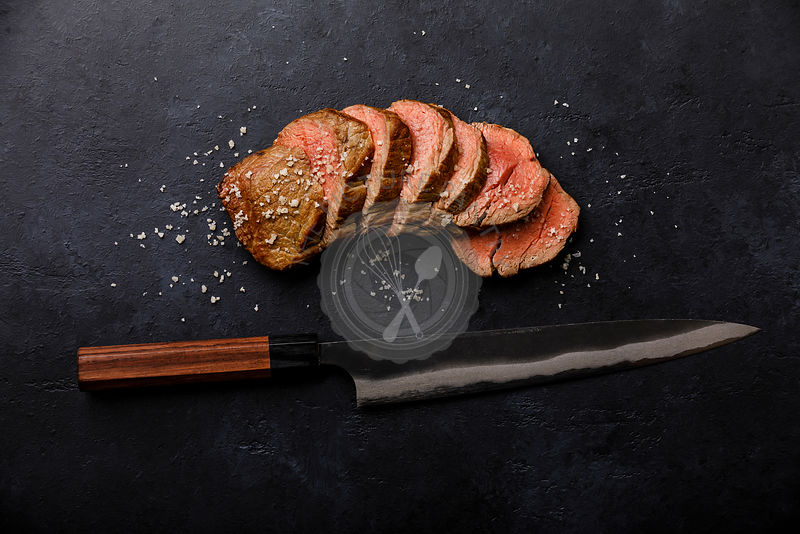 Sliced grilled meat barbecue Steak and kitchen Knife on black background