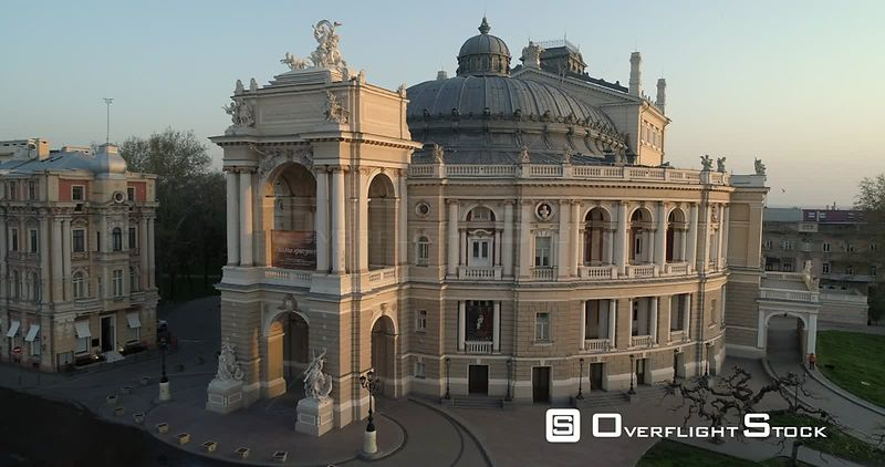 Aerial camera flies very slowly away from the Odessa Opera Theatre at sunrise Ukraine