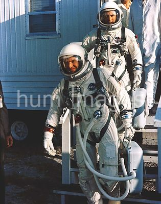 (21 Aug. 1965) --- Astronauts L. Gordon Cooper Jr. (foreground) and Charles Conrad Jr. leave suiting trailer at Pad 16 during...