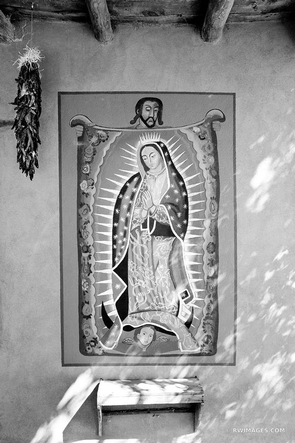 CATHOLIC WALL PAINTING AND RED CHILI PEPPERS RISTRAS TURQUOISE TRAIL NEW MEXICO BLACK AND WHITE VERTICAL