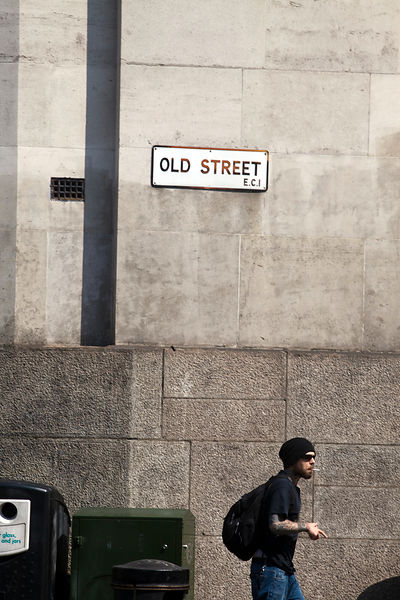 UK - London - A fashionably dressed young man walks along Old Street off Hoxton Square