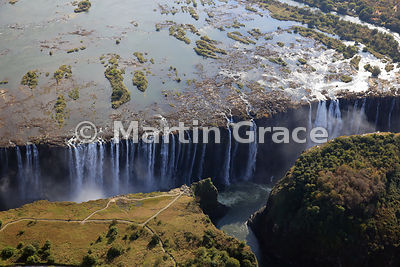 Victoria Falls (Mosi-oa-Tunya) from the air, mostly Zambia except for the paler headland left (west) foreground (Zimbabwe)