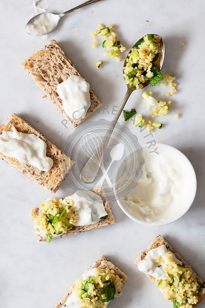 Cucumber tabouli salad and tzatziki dressing on toast fingers.