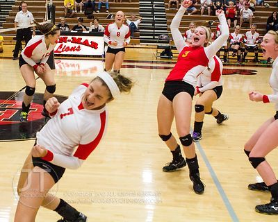 Marion players Kaela Halvorson (7), Abby Phillips (3) and their teammates celebrate a point scored at the 2012 Linn-Mar Varsi...