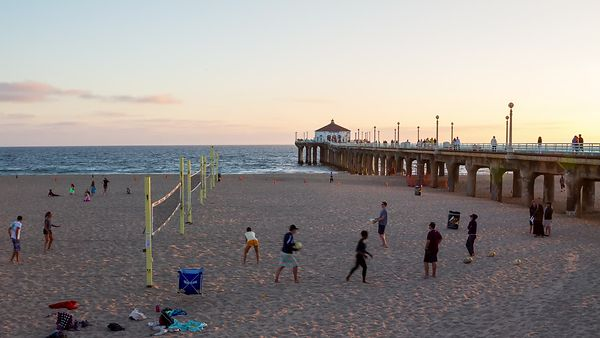 Medium Shot: Sunset Over a Game of Volley Ball & Manhattan Beach Pier