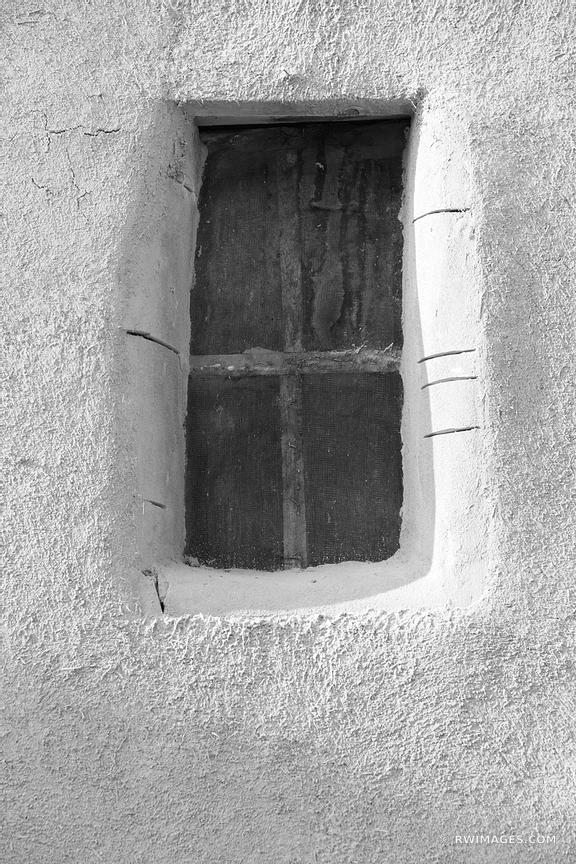 OLD WINDOW OLDEST HOUSE ADOBE BUILDING WALL SANTA FE NEW MEXICO BLACK AND WHITE VERTICAL