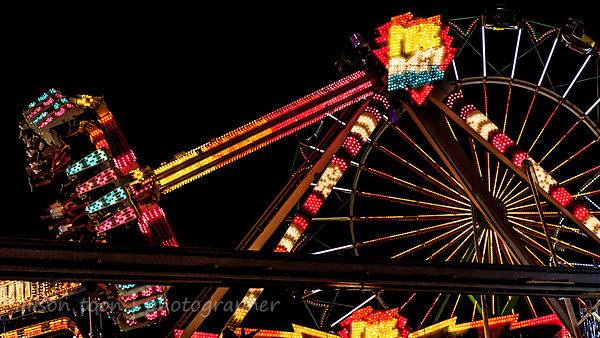 The Fairground or Midway at night