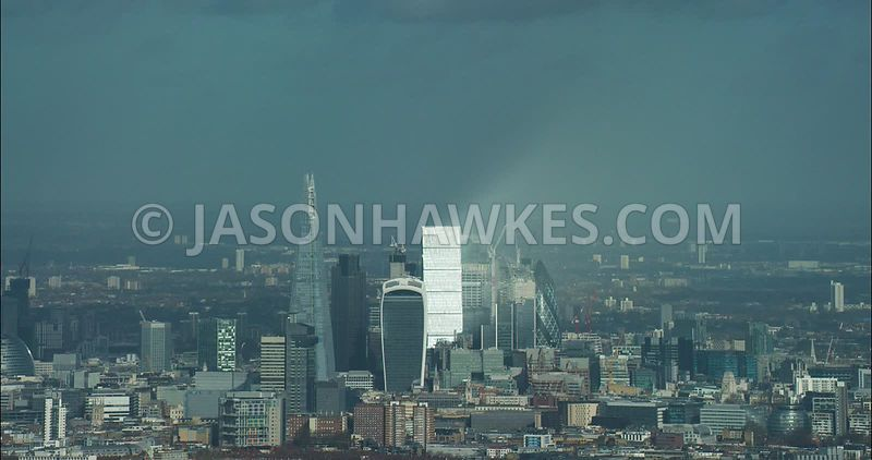 London Aerial footage, City of London skyline with The Shard.