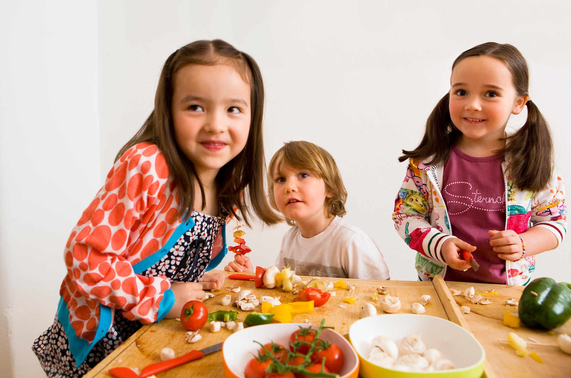 Children cooking together in kitchen
