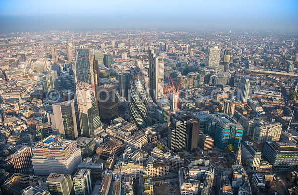 Aerial view of London, The Scalpel Building under construction with financial district.