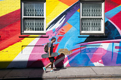 UK - London - Pedestrians walk through graffiti's streets in Shoreditch