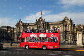 Ellos & Ellas magazine open topped double decker bus in front of government palace, Lima, Peru