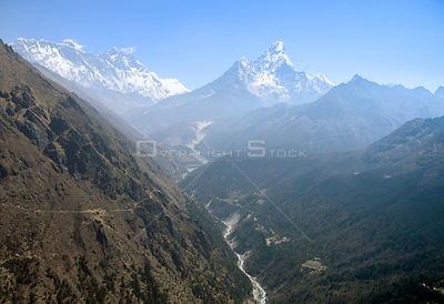 NEPAL Mount Ama Dablam -- 16 Apr 2005 -- Aerial view of Mount Ama Dablam (right, 6,856m), Mount Lhotse (left, 8,414) and on t...
