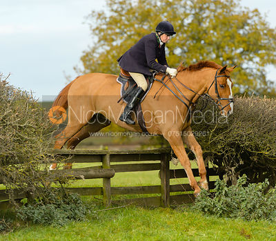 Gilly Bradley jumping a fence near Gartree Covert