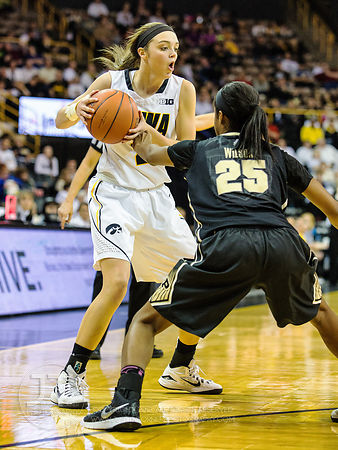 Iowa's Aly Disterhoft (2) jukes the defending Purdue's April Wilson (25) during the first half of play at Carver-Hawkeye Aren...
