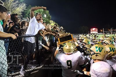 Iowa City West celebrates with its fans after winning over Iowa City High 52-6 at Frank Bates Field in Iowa City on Friday, S...