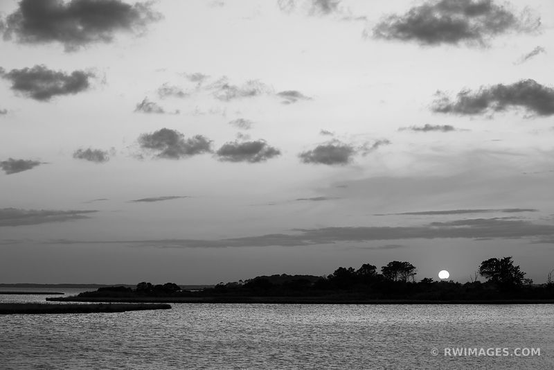 SUNSET OVER CHINCOTEAGUE BAY ASSATEAGUE ISLAND NATIONAL SEASHORE MARYLAND BLACK AND WHITE LANDSCAPE