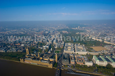 Aerial view over Houses of Parliament with Buckingham Palace in the background, London