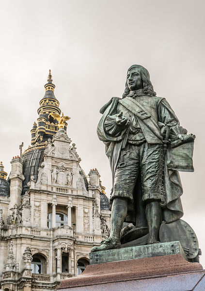 Statue of Flemish painter David Teniers the Younger against one of the impressing corner buildings at Teniersplaats in Antwer...
