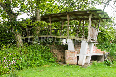 The Cloister Bridge, built 2004-2005, crosses a sunken track to connect the garden with a lower field. A trussed girder bridg...