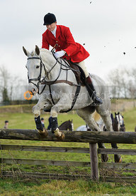 Nicholas Leeming MFH jumping a hunt jump at Windmill Farm - The Cottesmore Hunt at Bleak House