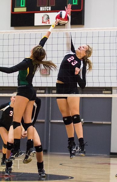Linn-Mar's Meg Gostonczik (23) blocks at the net a tip versus Dubuque Hempstead's Heather Splinter (9) at the 2012 Linn-Mar V...