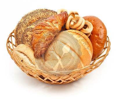 Arrangement of bread in basket on white background