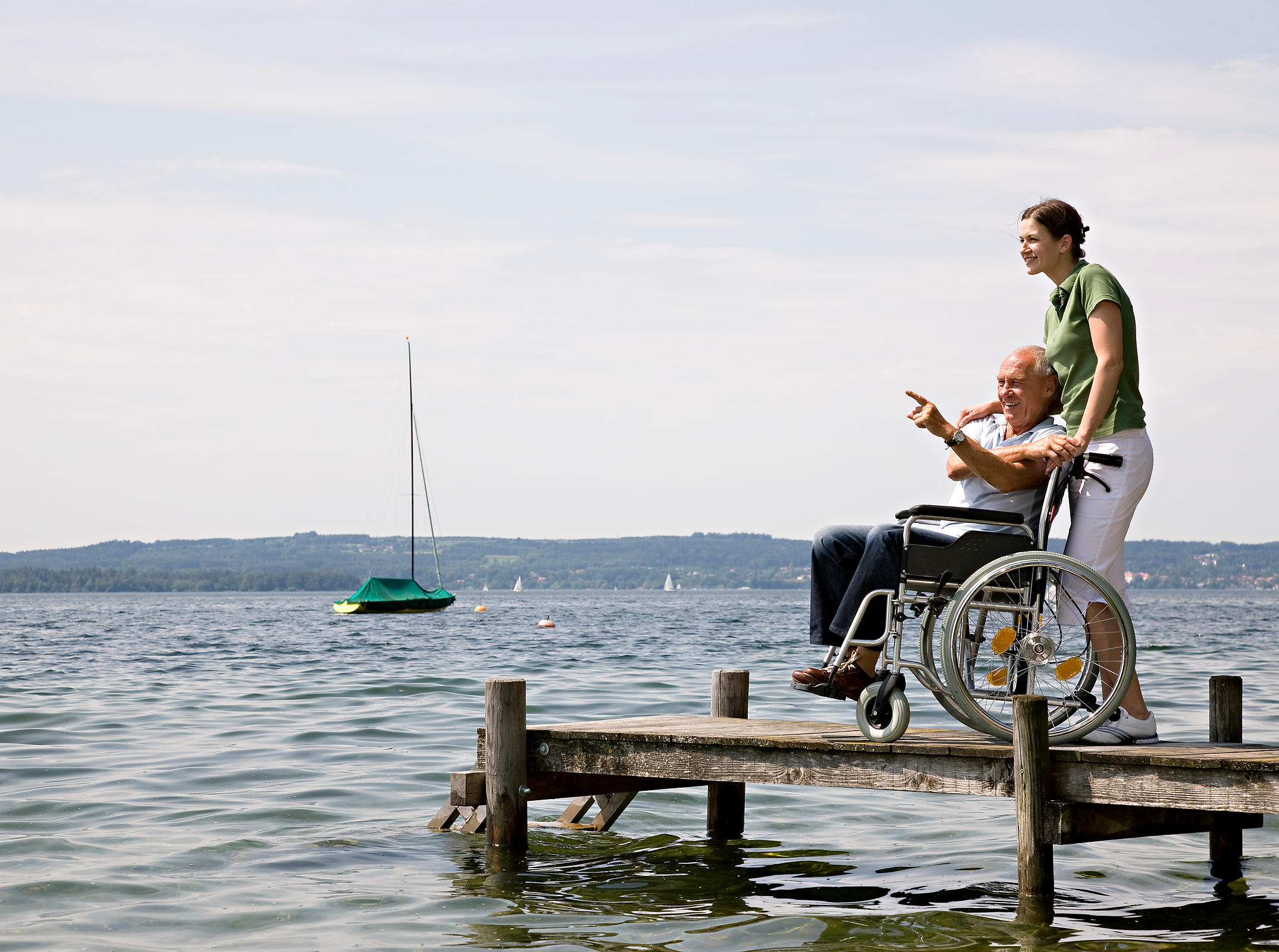 woman and senior man in wheelchair