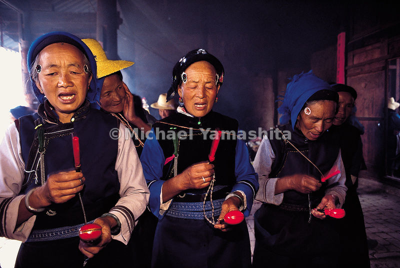 Once the rice crop is planted, the Bai tribe celebrates the Rao Shao Lin festival in Qindong Village in Dali.  Bai women pray...