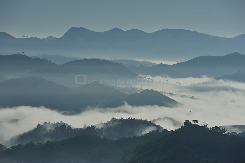 Aerial view of Sierra of Mantiqueira mountains in the early morning with mist in the valleys, from Visconde de Maua¡ locality...
