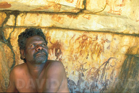 Indigenous Man with cave painting, North Western Australia