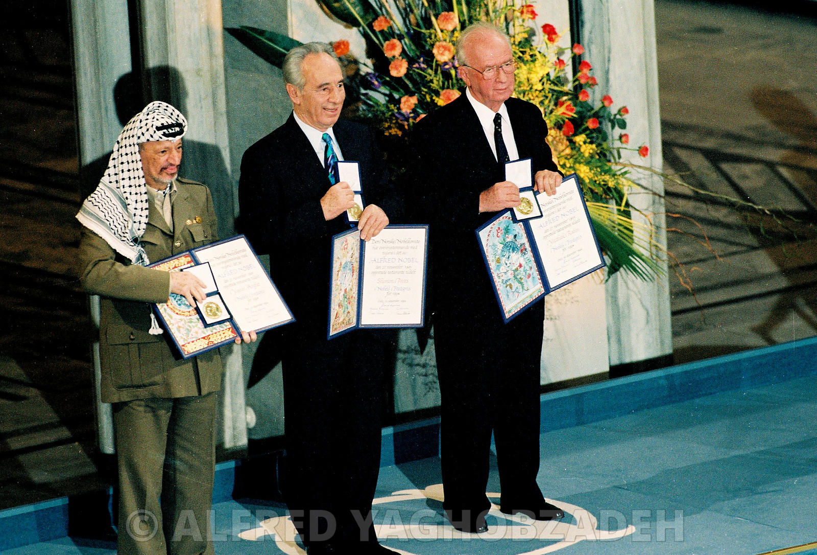 Yasser Arafat, Shimon Peres and Yitzhak Rabin showing their Nobel Peace Prize in Oslo.