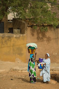 Women carrying laundry to the Senegal river, Street scene, Bakel, Senegal