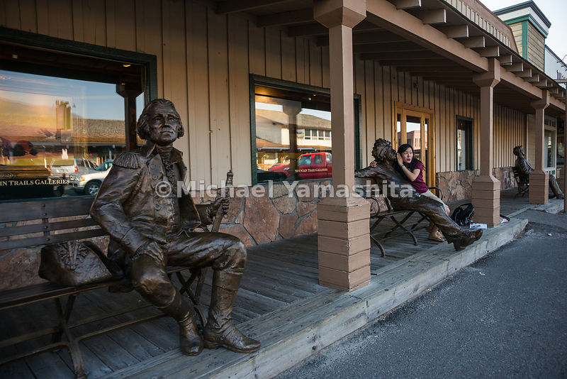 Bronze statues of historic figures such as George Washington and Albert Einstein in Town Square..Jackson, Wyoming...Jagged pe...