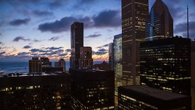 Bird's Eye: Deep Blue & Purple Sunset With Clouds Over Chicago High-Rises
