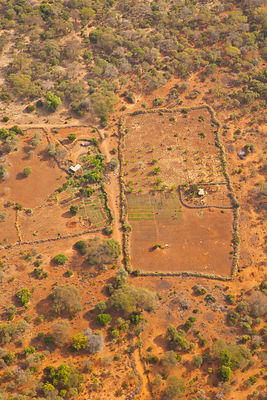 Aerial view of Maasai tribe homestead, with buildings and livestock enclusres. Rift Valley, Tanzania, Africa, August 2009